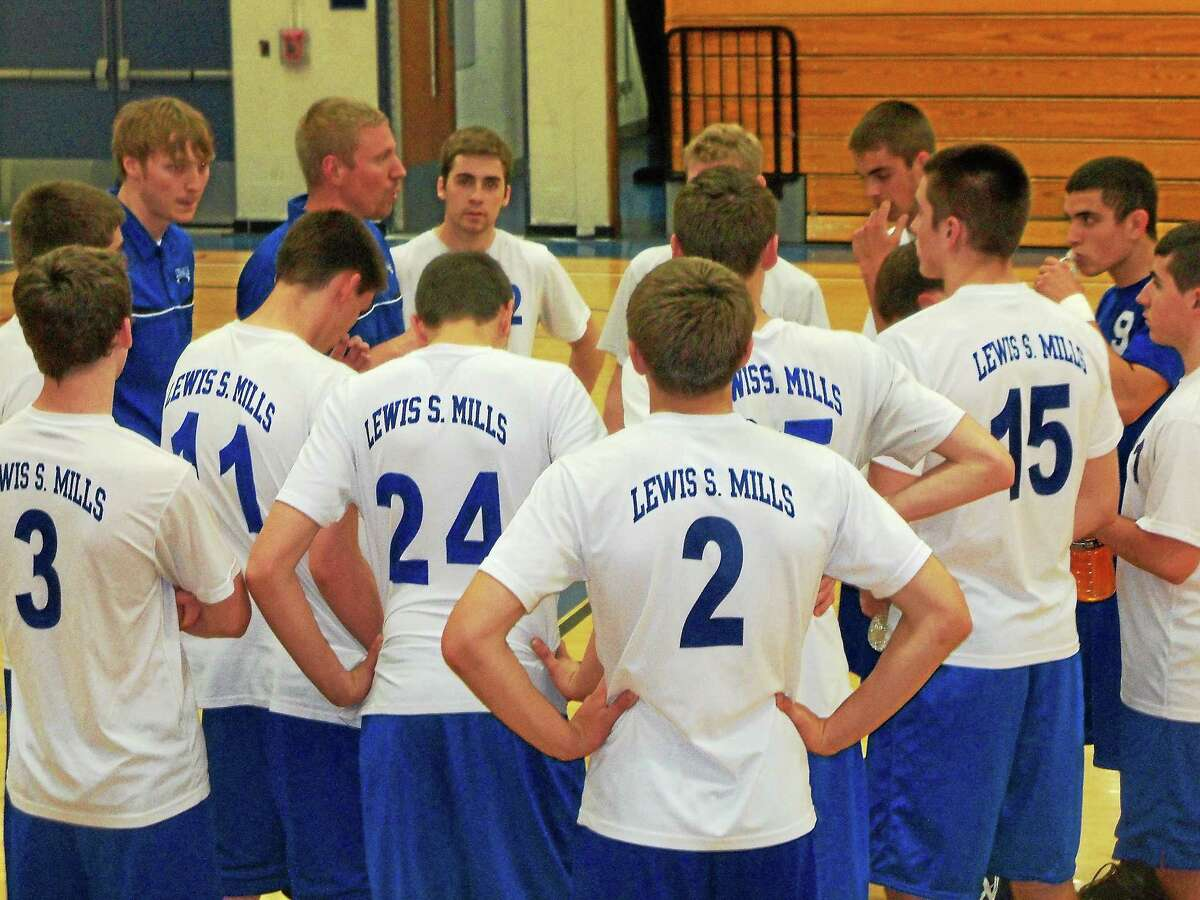 Lewis Mills coach Damian Coggshall talks to his team during the Spartans' 3-0 win over Farmington Friday evening at Lewis Mills High School.