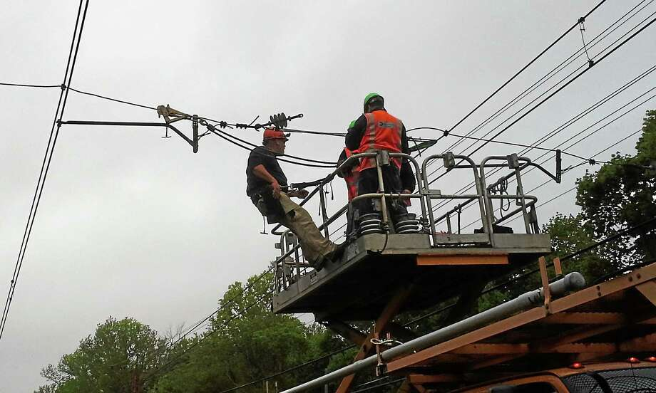 Crews repairing catenary wire damage near Cos Cob, which caused delays on the Metro-North New Haven line Friday. Photo: Contributed Photo — MTA Metro-North