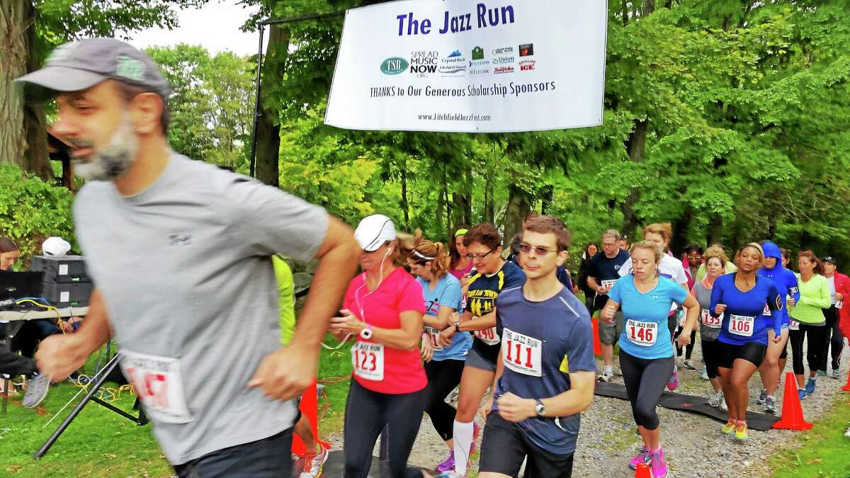 N.F. Ambery/Register Citizen Participants follow the course at the start of the Litchfield Jazz Run on Saturday, Sept. 13 in Goshen. The event was a fundraiser for the Litchfield Jazz Camp, offered to young musicians through Litchfield Performing Arts.
