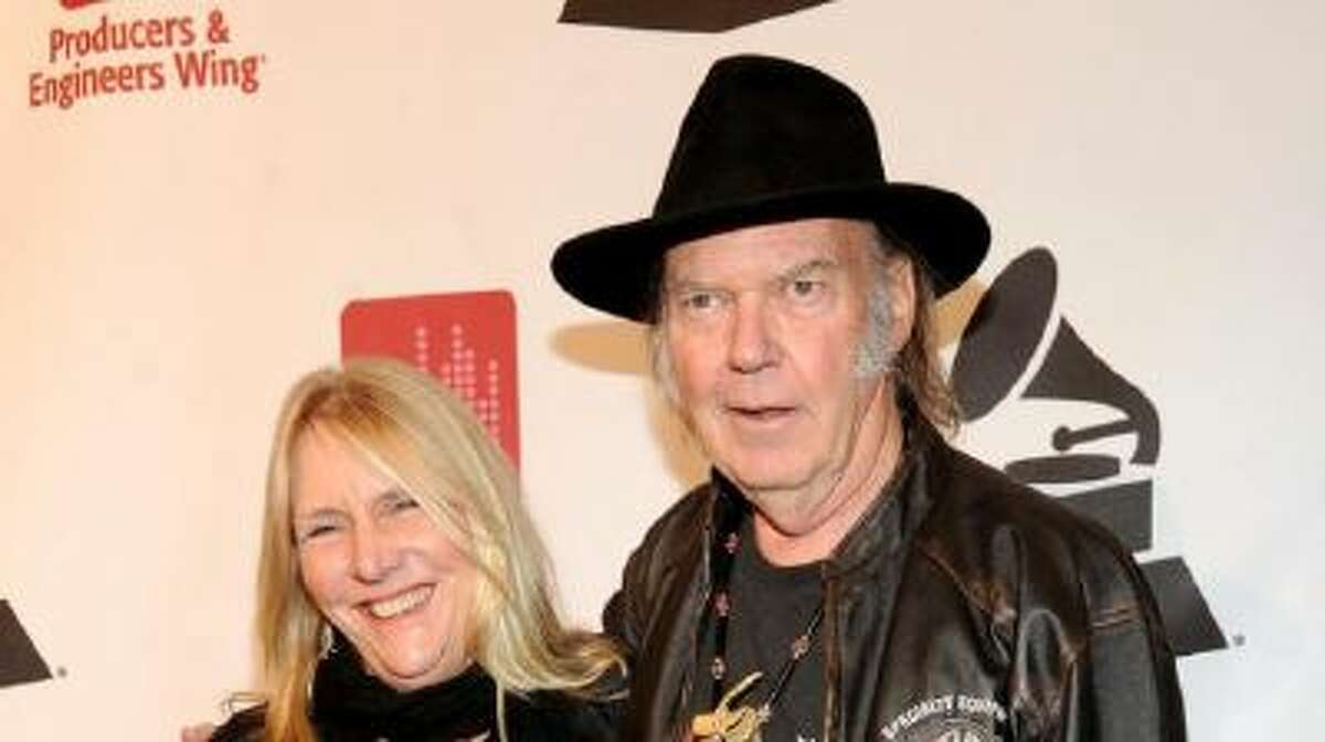 Honoree Neil Young, right, and Pegi Young arrive at the Producers and Engineers of The Academy's 7th Annual Grammy Week Event, at The Village Recording Studios, on Tuesday, Jan. 21, 2014, in Los Angeles.