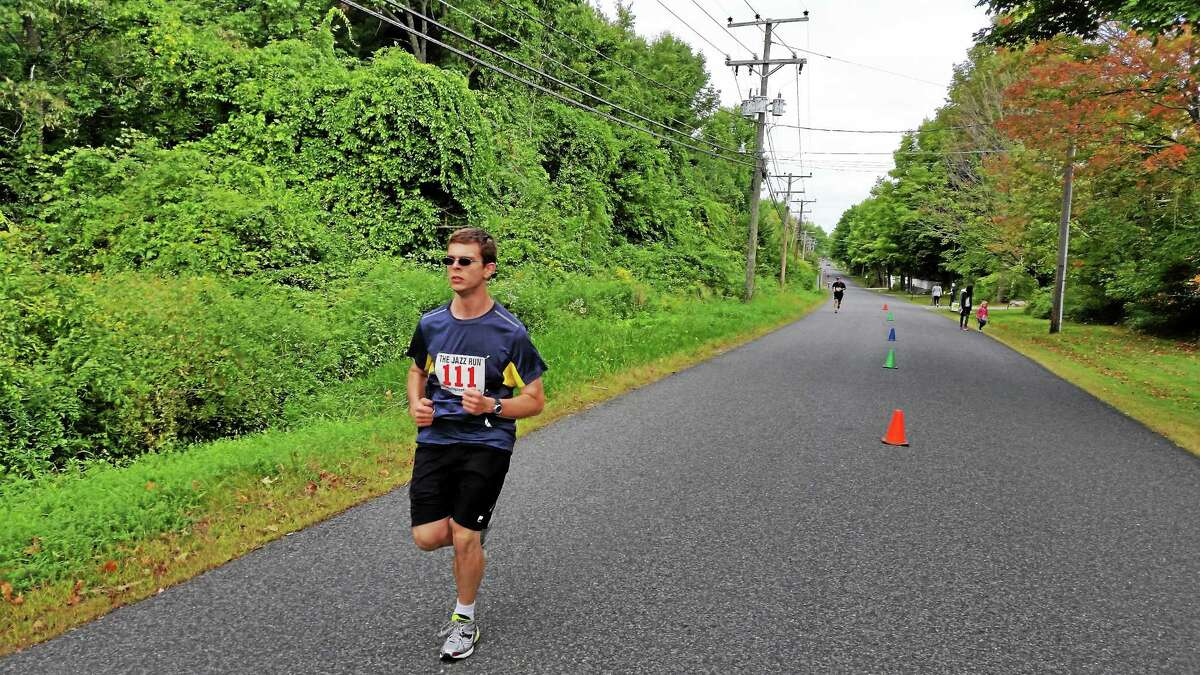 N.F. Ambery/Register Citizen A lone runner follows the Litchfield Jazz Run course on Beach Street in Goshen Saturday.