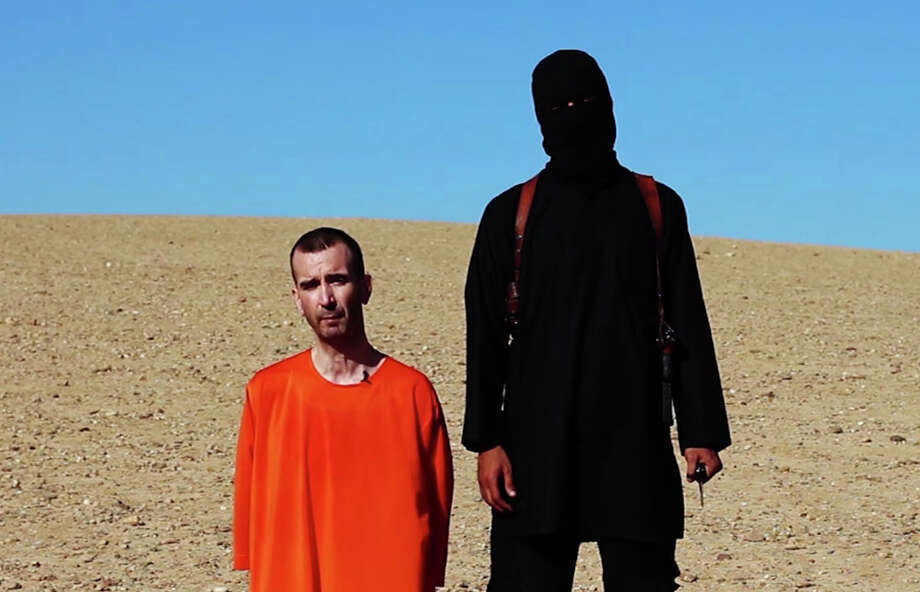 This image made from video posted on the Internet by Islamic State militants and provided by the SITE†Intelligence Group, a U.S. terrorism watchdog, on Saturday, Sept. 13, 2014, purports to show British aid worker David Haines before he was beheaded. Photo: (The Associated Press) / AP