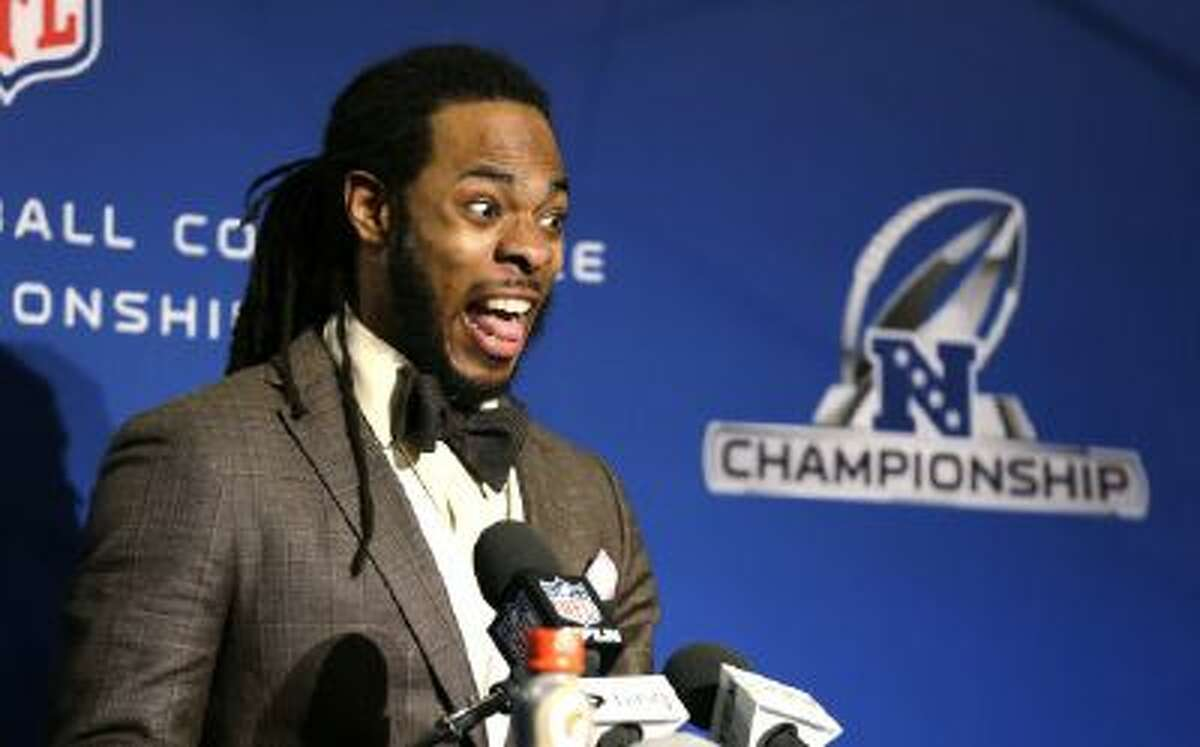 Seattle Seahawks' Richard Sherman talks to reporters after the Seahawks beat the 49ers to advance to the Super Bowl.