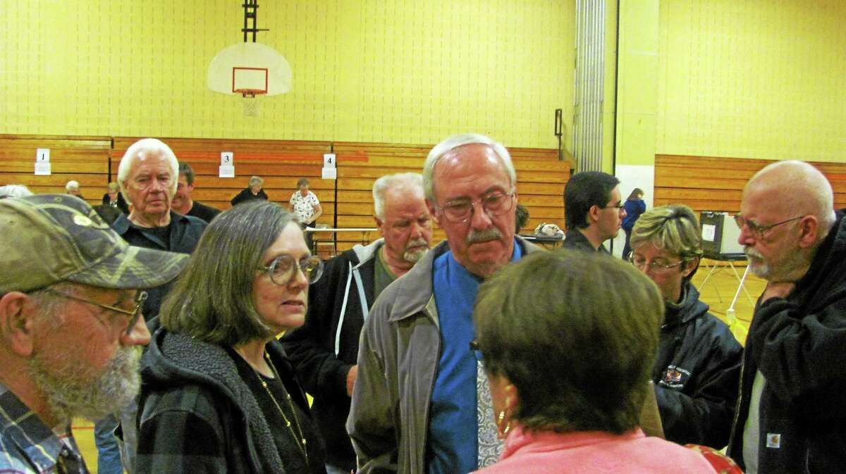 Democrat Steve Sedlak, center, was the top vote-getter in Saturday's special election in Winsted. His running mate, Virginai Charrette, left, lost to Republican Glenn Albanesius. Mayor Marsha Sterling lost.
