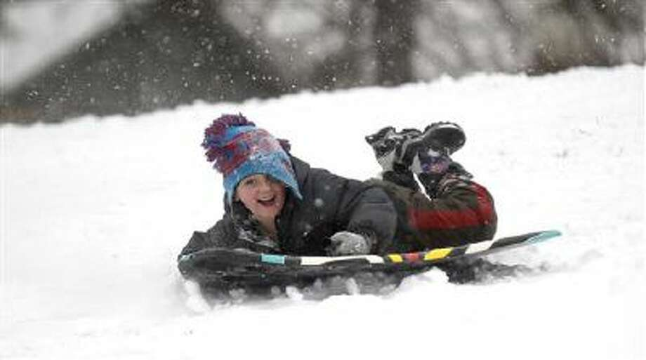 Eric Weiser, 5, of Lebanon, Pa., sleds down a hill Tuesday. The National Weather Service predicts the storm could drop 8 to 12 inches of snow followed by bitterly cold temperatures. Photo: AP / Lebanon Daily News
