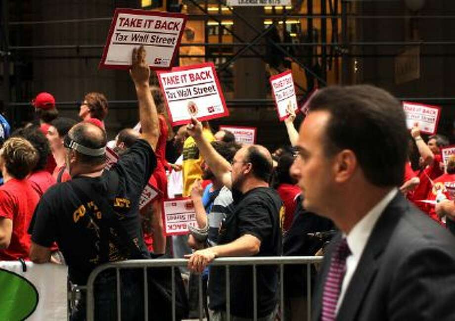A man walks by a union protest on Wall Street against financial intuitions and inequality in New York City in 2011. Photo: Getty Images / 2011 Getty Images