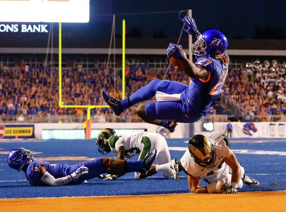 Boise State running back Jay Ajayi, shown here scoring a touchdown against Colorado State last week, ranks third nationally in all-purpose yards. Photo: Otto Kitsinger — The Associated Press  / FR171002 AP