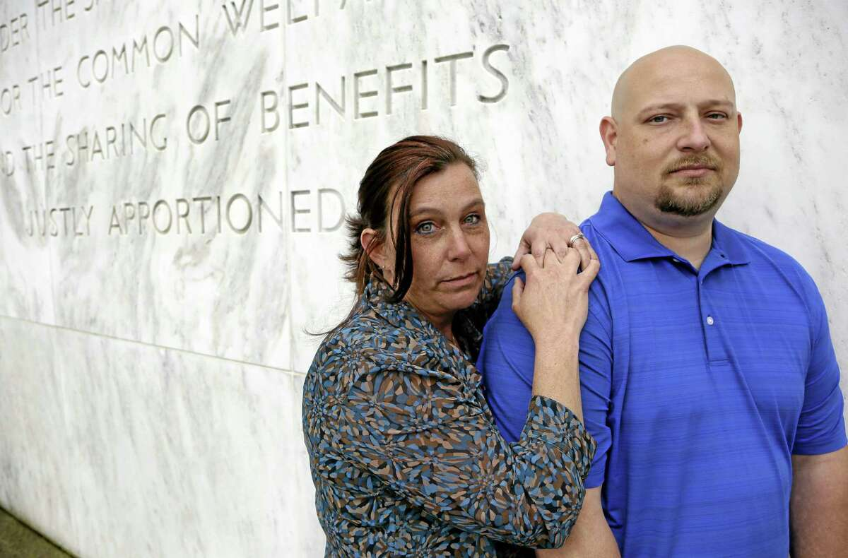 In this May 8, 2014 photo, former Spartanburg, S.C., sheriff's deputy Brandon Bentley, poses for a photo with his wife, retired Salem police department officer Kelly Clark, in front of the Capitol building in Salem, Ore. Bentley's appeal to the South Carolina Supreme Court on a post-traumatic stress disorder claim was denied, stating the law did not provide mental health benefits for officers because they are trained in the use of deadly force and know that they may have to use it. (AP Photo/Don Ryan)