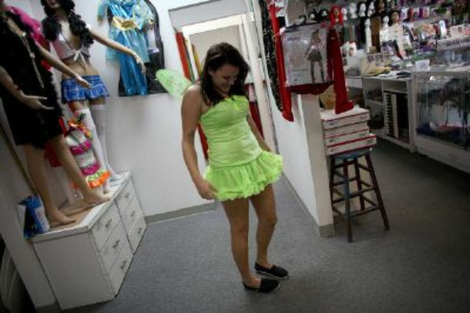 Sarah Helton puts together a Halloween costume at Dixon Costumes, Inc on October 23, 2013 in Miami, Florida. Photo: Getty Images / 2013 Getty Images