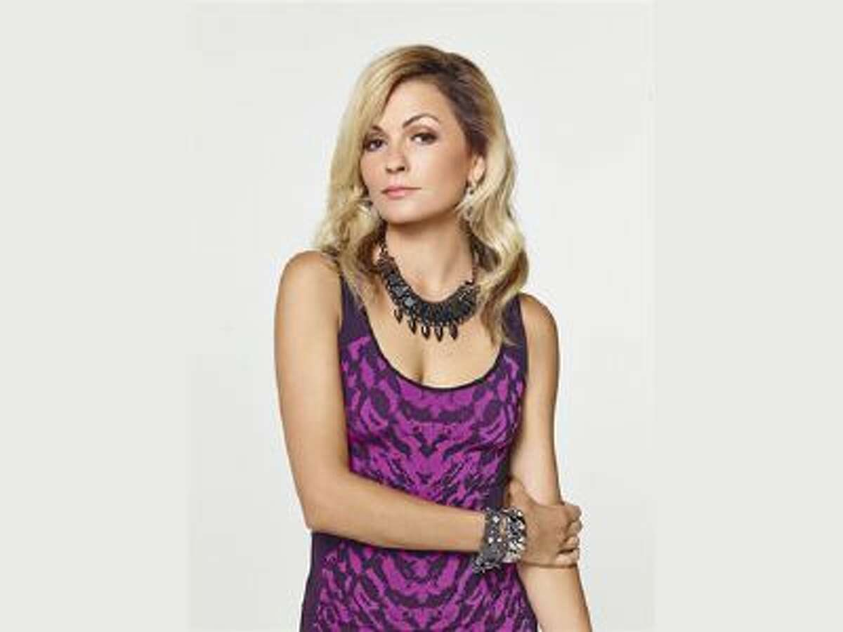This photo released by The CW Network shows Lindsey Gort as Samantha Jones in the