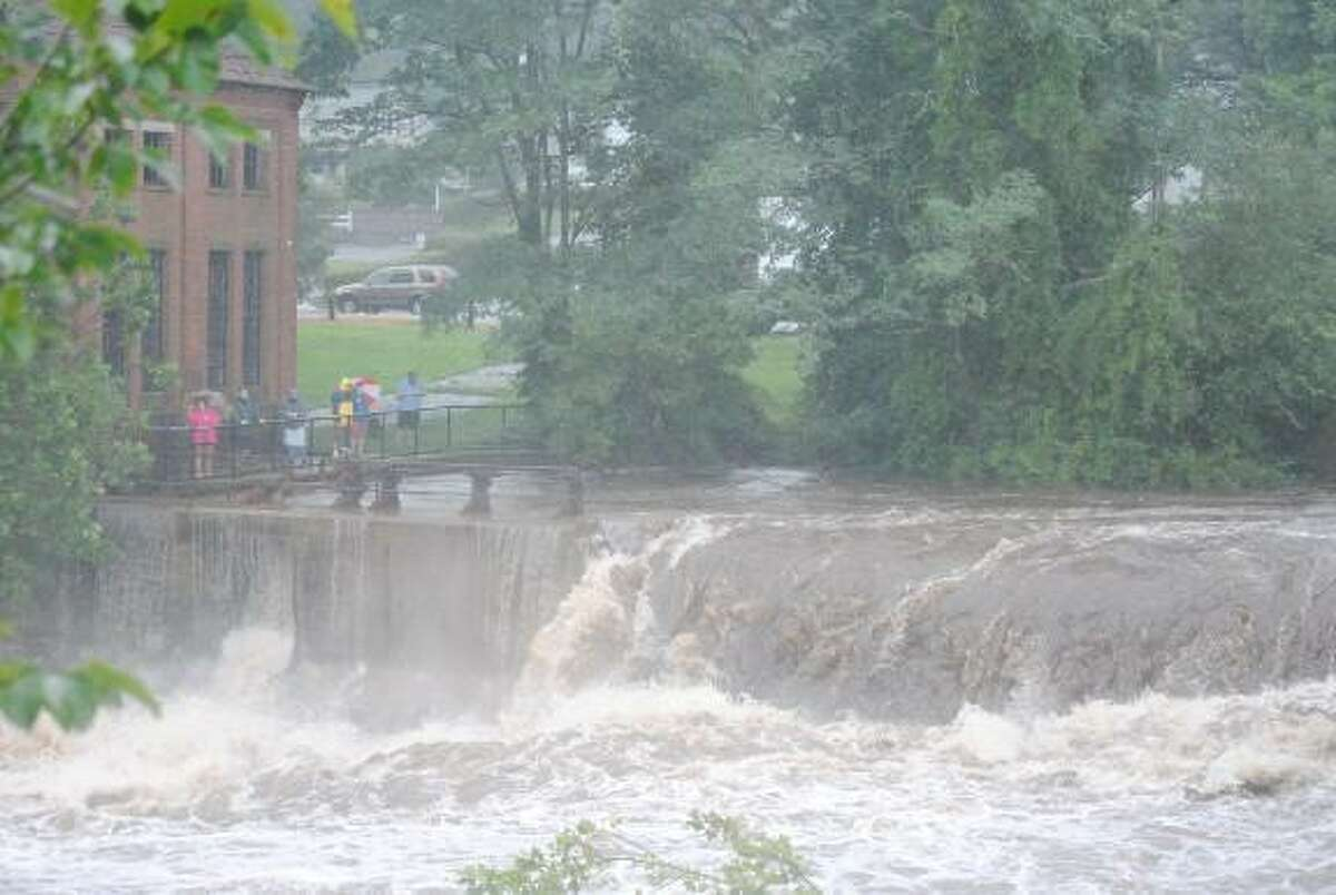 The Farmington River rages near the Upper Collinsville Dam. File photo.