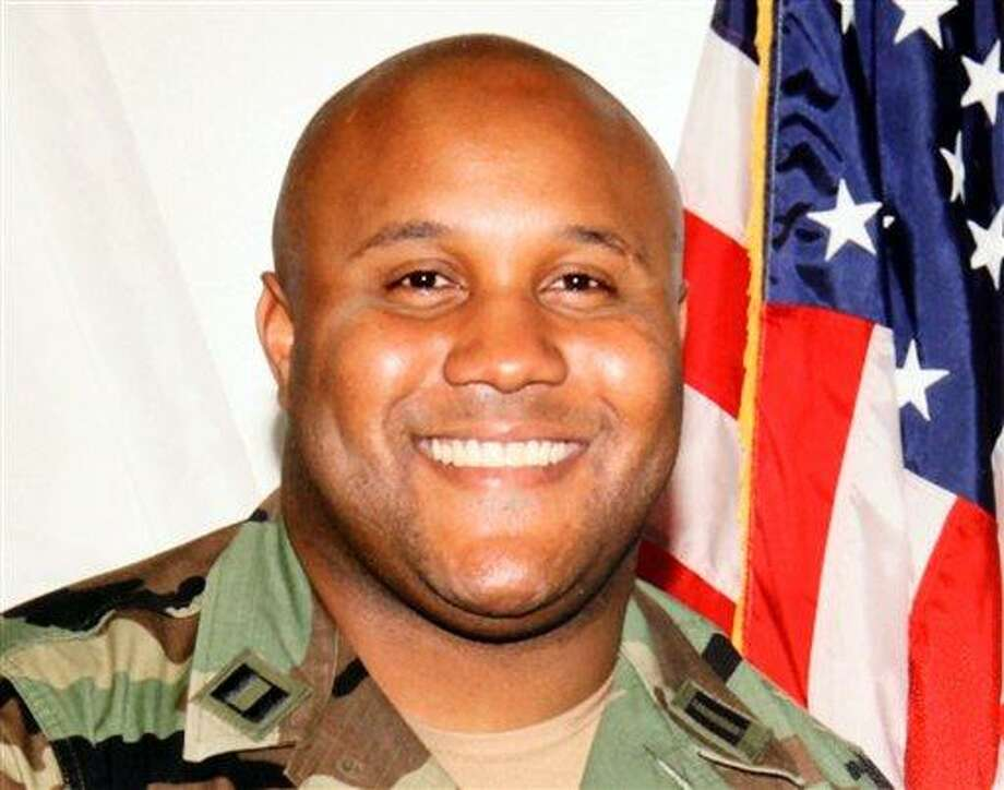 This undated photo released by the Los Angeles Police Department shows suspect Christopher Dorner, a former Los Angeles officer. Seeking leads in a massive manhunt, Los Angeles authorities on Sunday put up a $1 million reward for information leading to the arrest of Christopher Dorner, the former Los Angeles police officer suspected in three killings. (AP Photo/Los Angeles Police Department) Photo: AP / Los Angeles Police