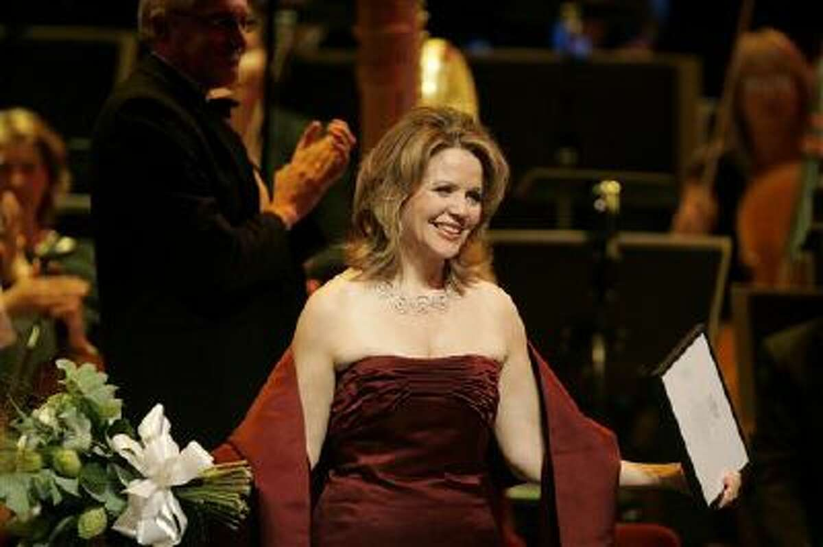 American soprano Renee Fleming reacts after receiving the Polar Music Prize from King Carl XVI Gustaf of Sweden.