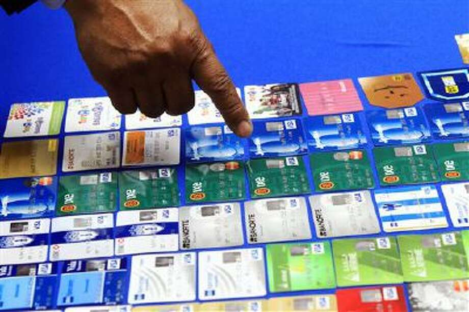 Police Chief Victor Rodriguez points at dozens of fraudulent credit cards that were confiscated by McAllen, Texas, police after arresting a man and a woman on fraud charges tied to the December Target credit card breach. Photo: AP / The Monitor