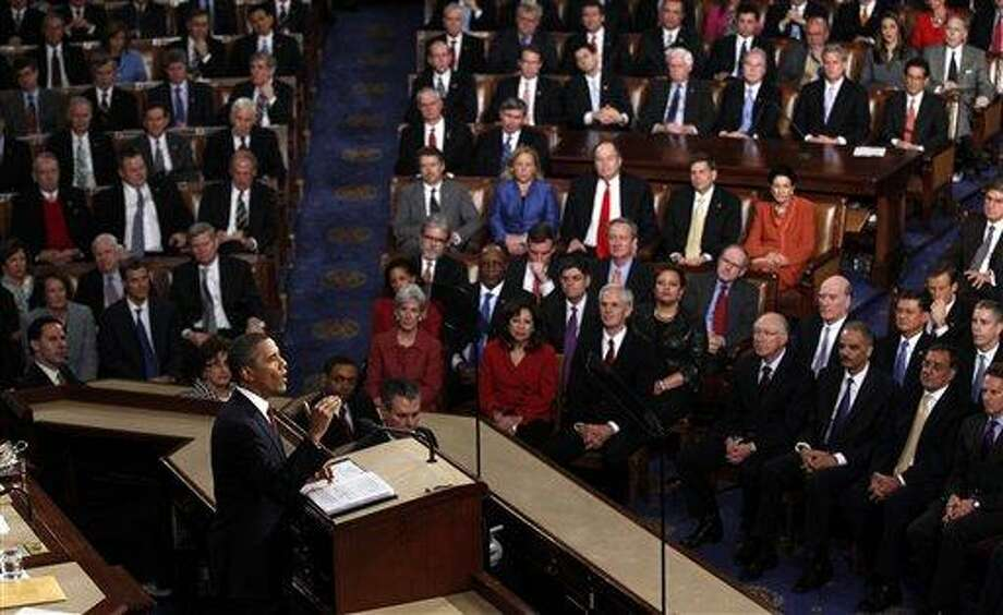FILE - In this Jan. 24, 2012 file photo, President Barack Obama delivers his State of the Union address on Capitol Hill in Washington. As President Barack Obama delivers his State of the Union speech Tuesday night, Feb. 12, 2013, he presides over an economy much healthier than the one he inherited four years ago. Yet growth remains slow and unemployment high. (AP Photo/Evan Vucci, File) Photo: AP / AP