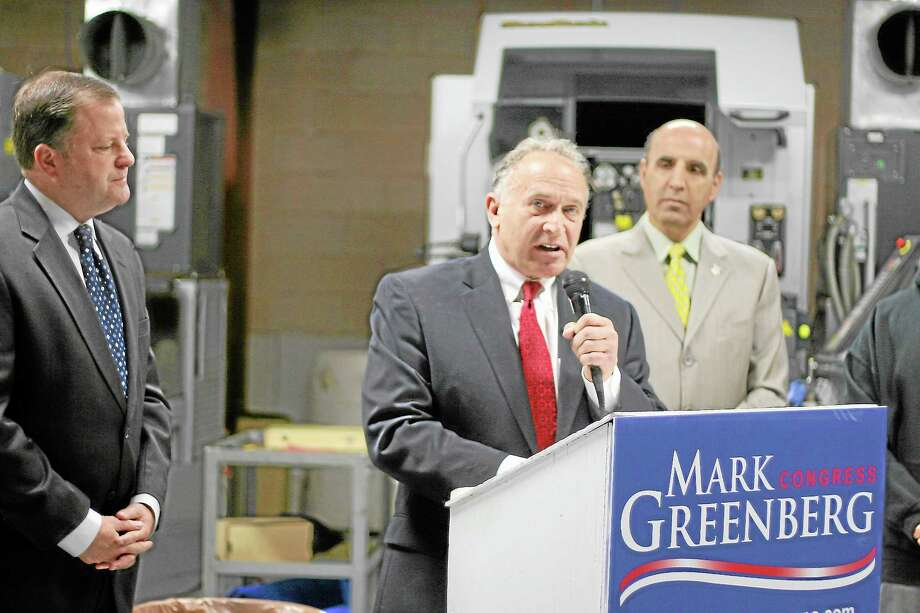 (CHRISTINE STUART-CTNewsJunkie.com) Mark Greenberg (center) accepting the endorsement from Sen. John McKinney (left) at an event in December. Greenberg's congressional campaign rolled out its first TV ad Friday. Photo: Journal Register Co.