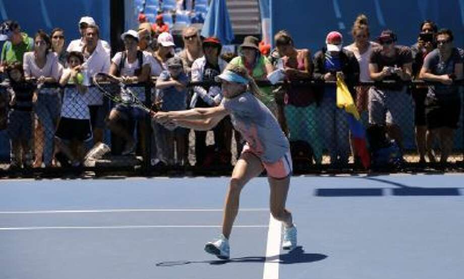 Eugenie Bouchard of Canada plays a shot during a training session at the Australian Open tennis championship in Melbourne, Australia, Wednesday, Jan. 22, 2014.