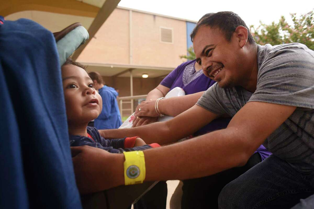 Carlos Rodriguez reaches for his 22-month-old son, Ian, at the Kazen Middle School evacuee shelter on Sunday, Aug. 27, 2017. The Rodriguez family, who is from Robstown, evacuated as Hurricane Harvey approached. Ian is a special needs child .