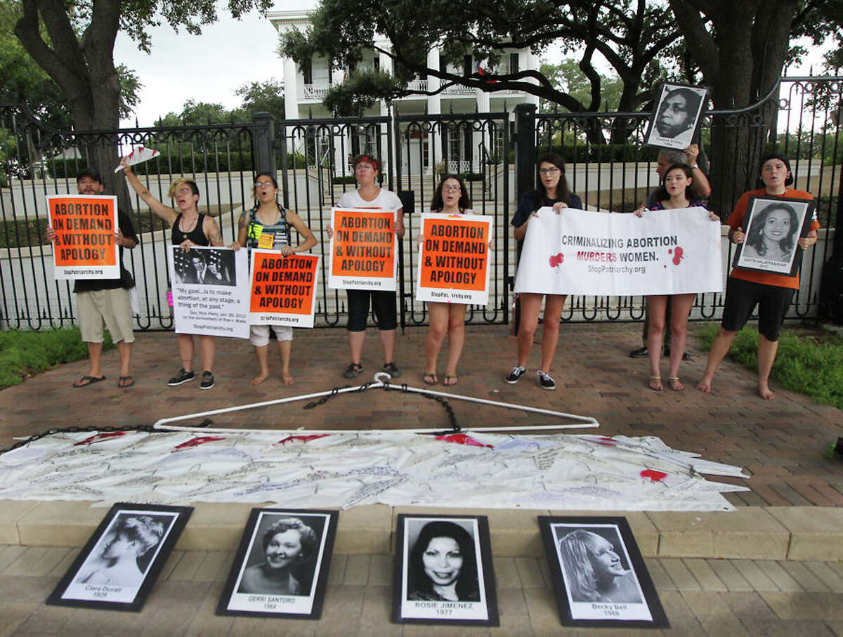 Abortion rights supporters take a stand outside the governorís mansion Friday, Aug. 29, 2014, after a federal judge in Austin struck down two provisions of the 2013 Texas law that restricts abortions. (AP Photo/Austin American-Statesman, Rodolfo Gonzalez)