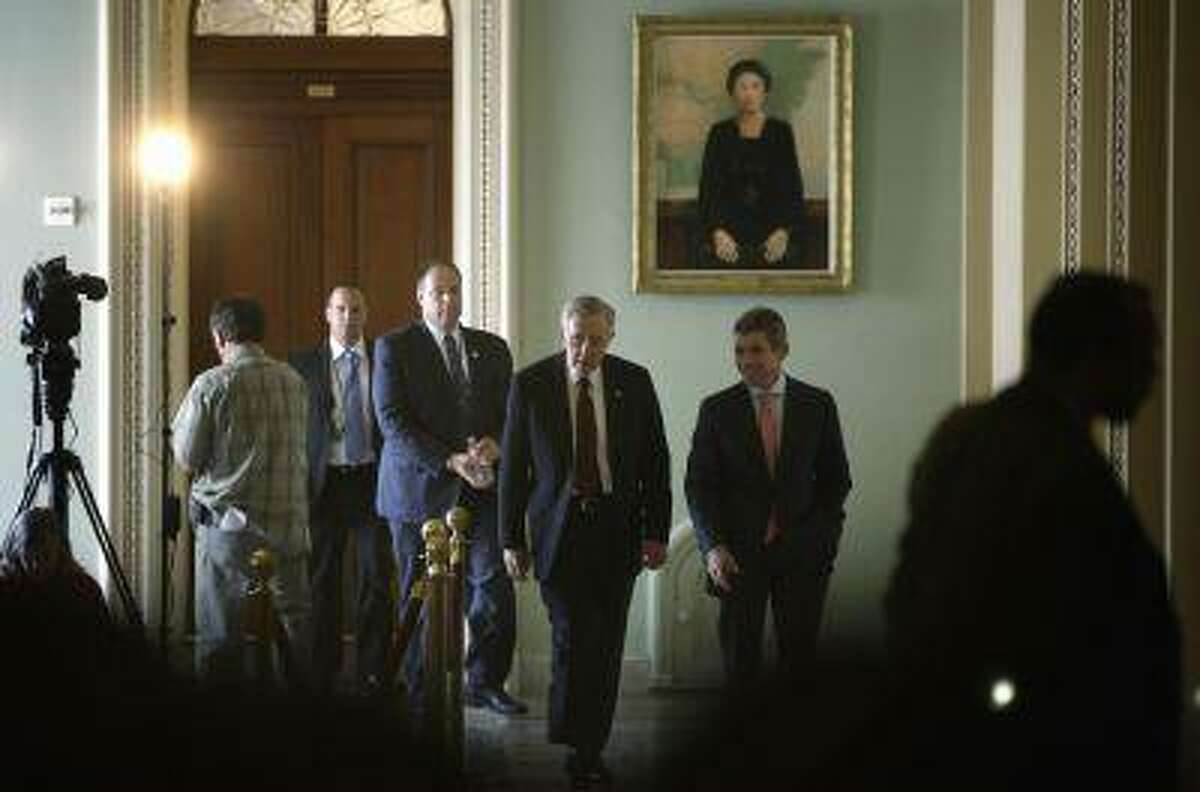 U.S. Senate Majority Leader Harry Reid (D-NV) (front C) walks with aides near the U.S. Senate chamber at the U.S. Capitol during immigration debates in Washington, June 20, 2013. (Jonathan Ernst/Reuters)