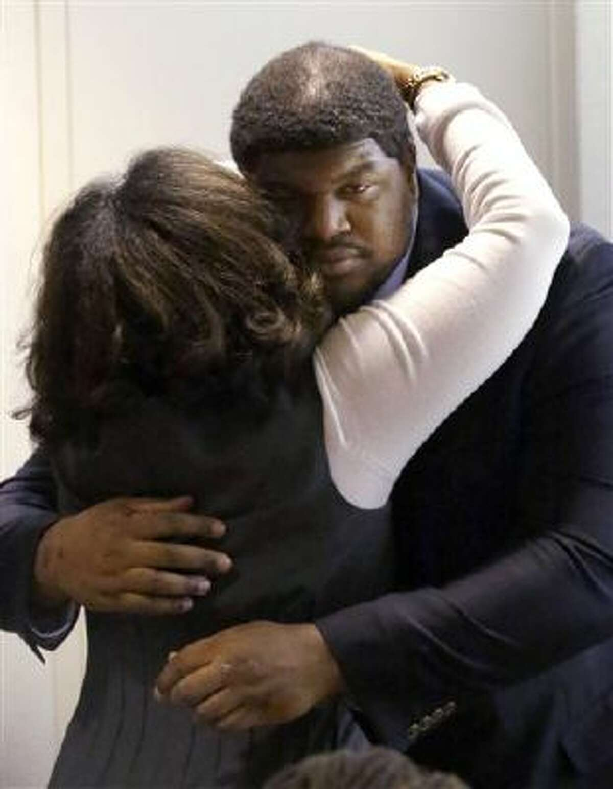 Former Dallas Cowboys NFL football player Josh Brent gets a hug from family after closing arguments in his intoxication manslaughter trial Tuesday, Jan. 21, 2014, in Dallas. The jury has begun deliberating in Brent's intoxication manslaughter trial after lawyers wrapped up their closing arguments Tuesday morning. Prosecutors accuse the former defensive tackle of drunkenly crashing his Mercedes near Dallas during a night out in December 2012, killing his good friend and teammate, Jerry Brown.