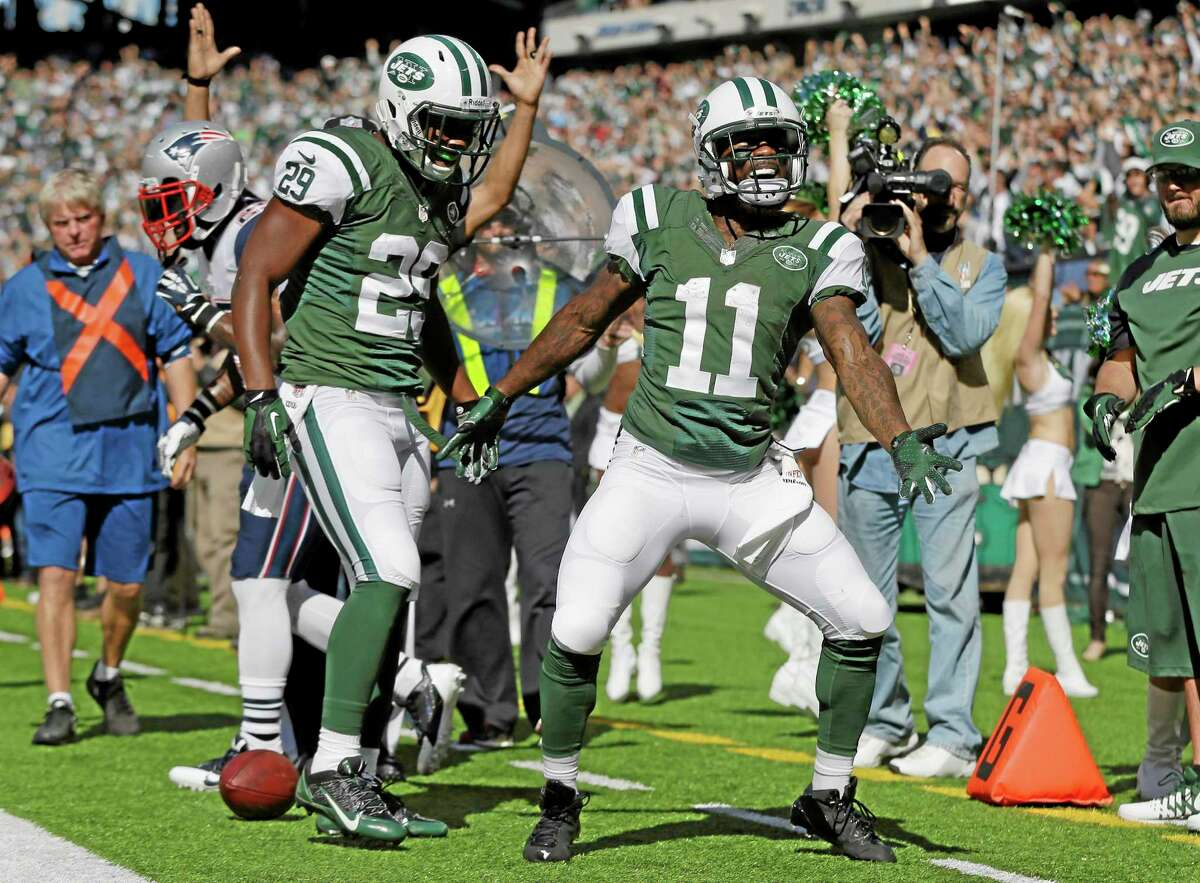 New York Jets wide receiver Jeremy Kerley (11) and Bilal Powell (29) celebrate a Kerley touchdown Sunday against the New England Patriots in East Rutherford, N.J.