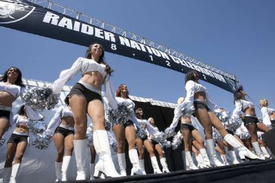 "The Oakland Raiders cheerleading squad, the Raiderettes, are suing the team for ""wage theft"" and other ""unfair employment practices."" Photo: D. ROSS CAMERON / Bay Area News Group"