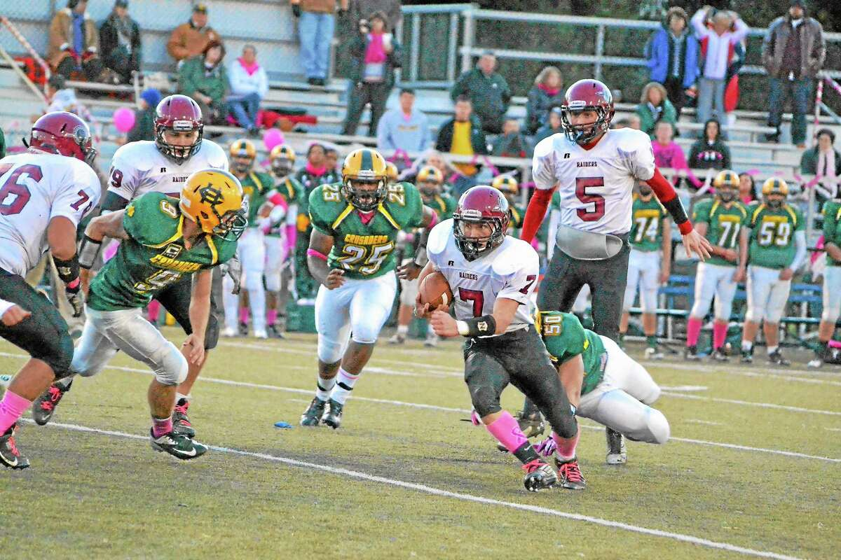 Torrington's Tyler Marens runs up field during the Red Raiders 41-21 loss to Holy Cross. Marens ran for 82-yards.