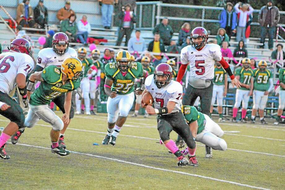 Torrington's Tyler Marens runs up field during the Red Raiders 41-21 loss to Holy Cross. Marens ran for 82-yards. Photo: Pete Paguaga — Register Citizen