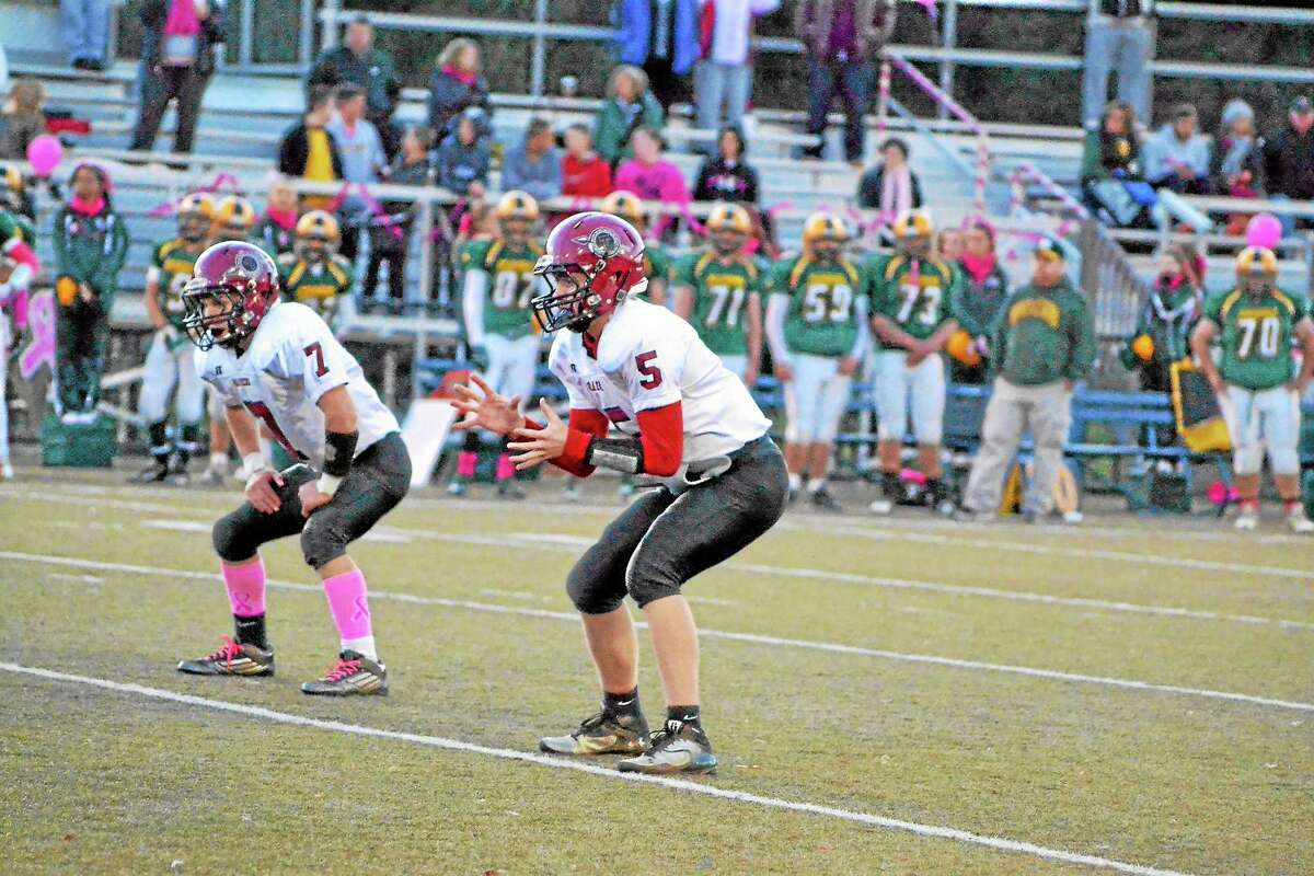 Torrington's Connor Finn prepares to take a snap. Finn went 19-37 for 288 yards and two touchdowns in the loss.