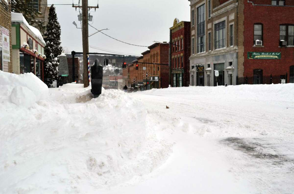 Snow plows and drifts made the sidewalks impossible to traverse in Torrington on Saturday morning.John Berry/Register Citizen