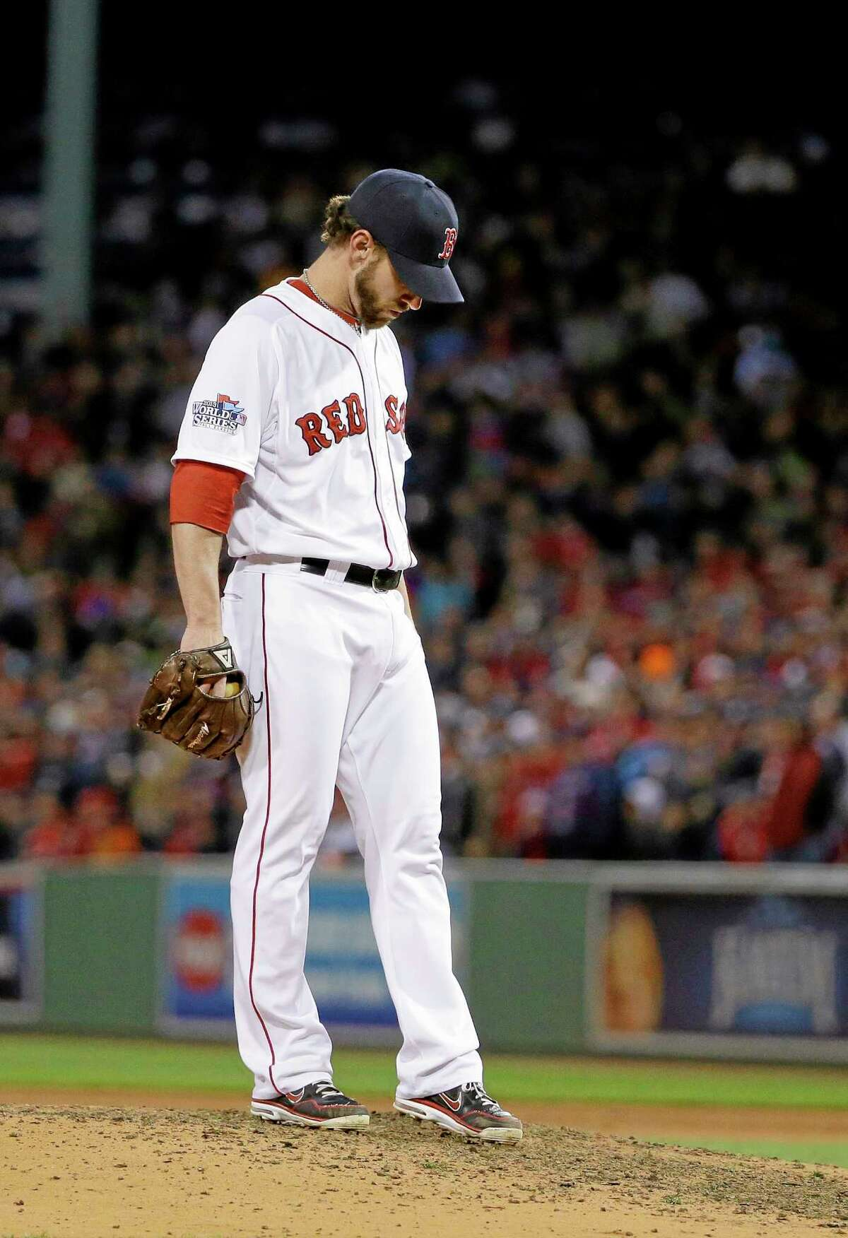 Red Sox reliever Craig Breslow waits to be taken out during the seventh inning on Thursday.