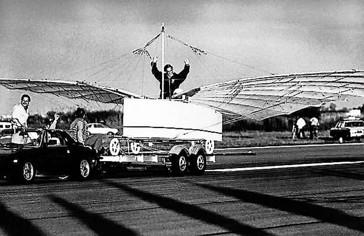 Actor Cliff Robertson signals success after he test-piloted a replica of an airplane challenging the Wright brothers' status as the first to fly on Friday morning, July 11, 1986 in a tethered test flight at Sikorsky Memorial Airport in Stratford, Conn. The aircraft, in the test flight, rose off the trailer while being towed. Its builders want to prove that Gustave Whitehead a Connecticut Aviation pioneer, flew in 1901. AP Photo