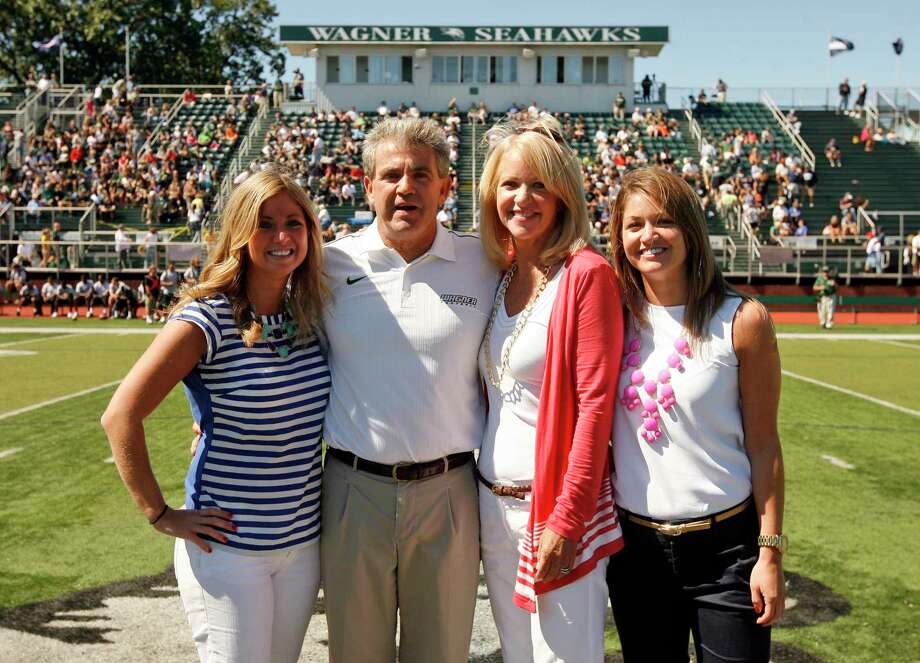 Wagner football coach Walt Hameline, second from left, pose with his family, from left, daughter Kristin, wife Debi and daughter Kelly. You think fall weddings are inconvenient for college football fans? Imagine being a coach with a daughter who has her heart set on a Saturday in late September. That was Hameline's dilemma, when his youngest daughter, Kelly, told him last fall the place she chose as the site of her big day had few dates available, and the one she picked was Sept. 20, the same day Wagner was scheduled to play Monmouth University. With the help of an old friend, Hameline was able to reschedule the game. Photo: The Associated Press  / Wagner College