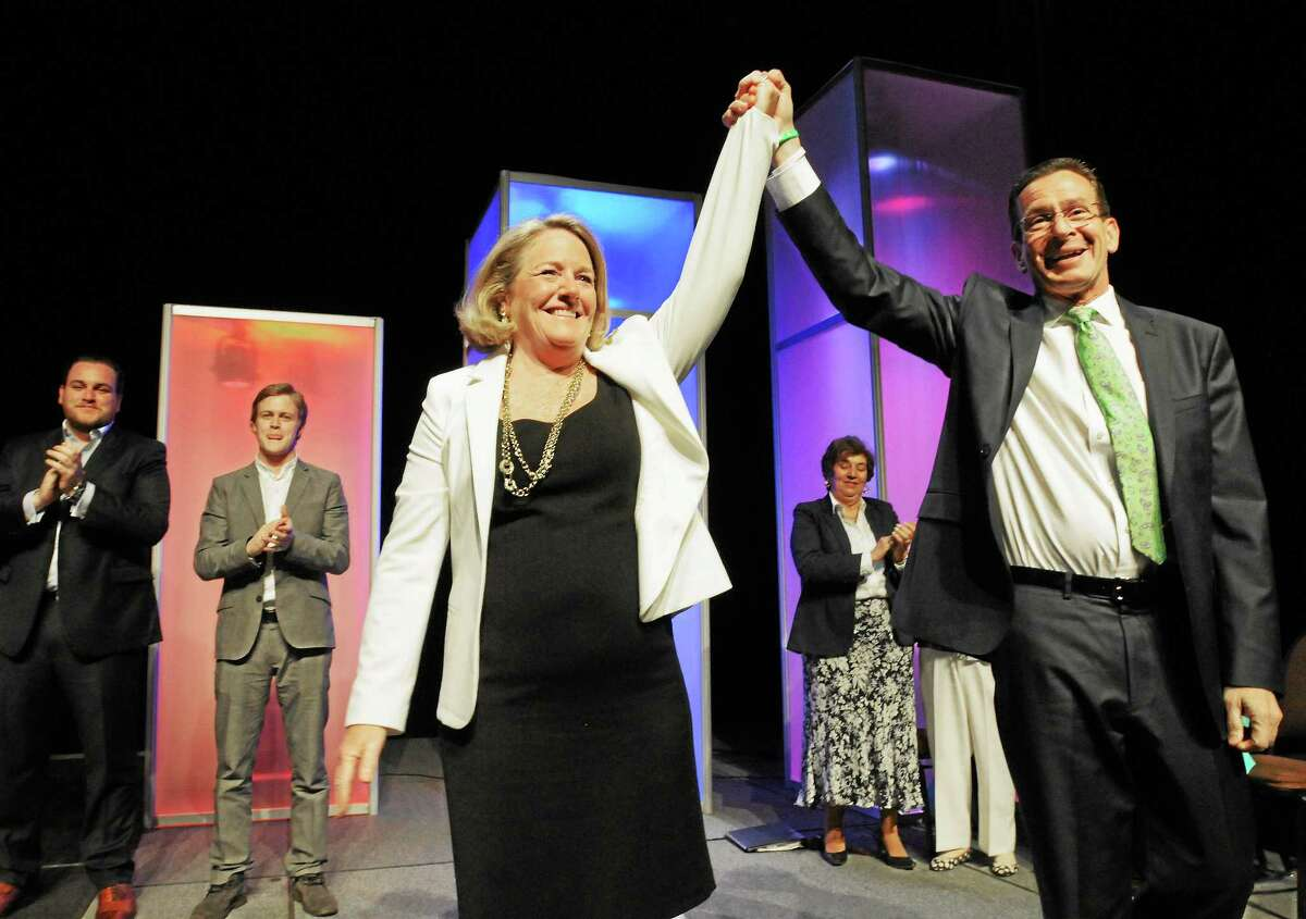 Gov. Dannel P. Malloy and his wife Cathy celebrate his nomination at the 2014 Connecticut Democratic Convention in Hartford Friday.