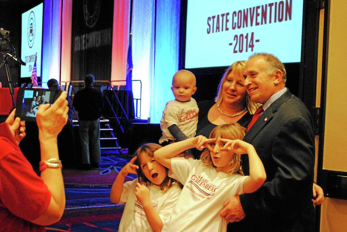 Mark Greenberg and his family take a photo as the delegates announce which candidate they voted for at the 2014 Connecticut Republican Convention at the Mohegan Sun Convention Center in Uncasville Friday.