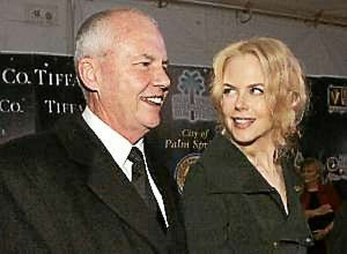 In this Jan. 8, 2005, file photo, psychologist Antony Kidman, left, and his daughter, actress Nicole Kidman, arrive to the Palm Springs International Film Festival.