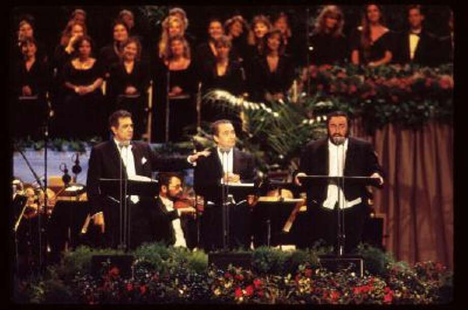 Singers Placido Domingo, Jose Carreras and Luciano Pavarotti (from left to right) perform in Dodgers Stadium July 16, 1994 in Los Angeles, CA. The trio, known as 'The Three Tenors,' performed to commemorate the end of the 1994 World Cup soccer tournament, which was the first to be held in the US. Photo: Getty Images / Hulton Archive