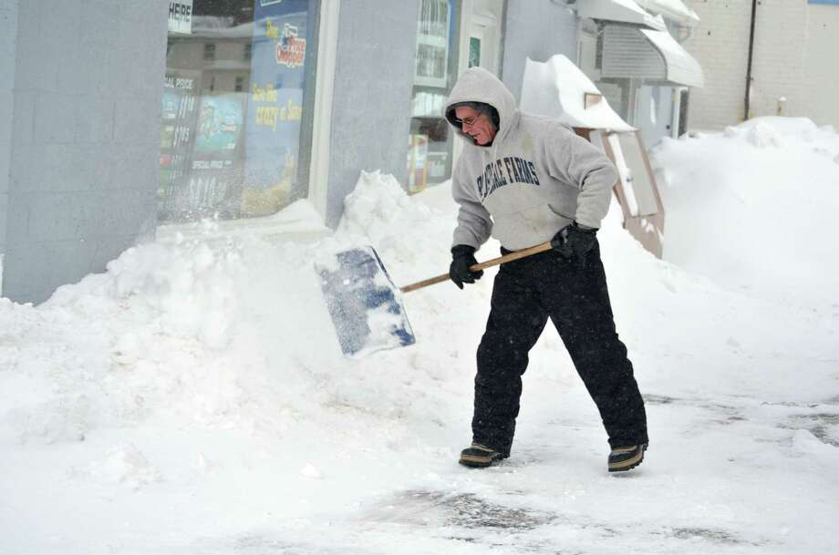 Matthew Gourley helps shovel out the Sunoco on Migeon ave in Torrington Saturday morning.John Berry/Register Citizen