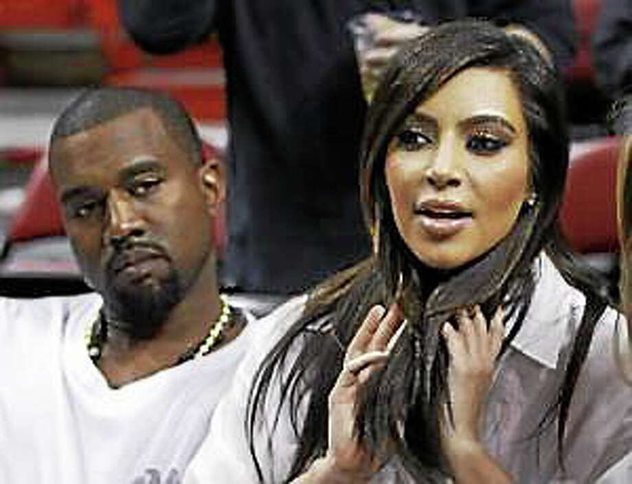 Kim Kardashian, right, and Kanye West, left, are shown before an NBA basketball game between the Miami Heat and the New York Knicks in this Dec, 6, 2012, file photo taken in Miami. Photo: (Alan Diaz — The Associated Press)