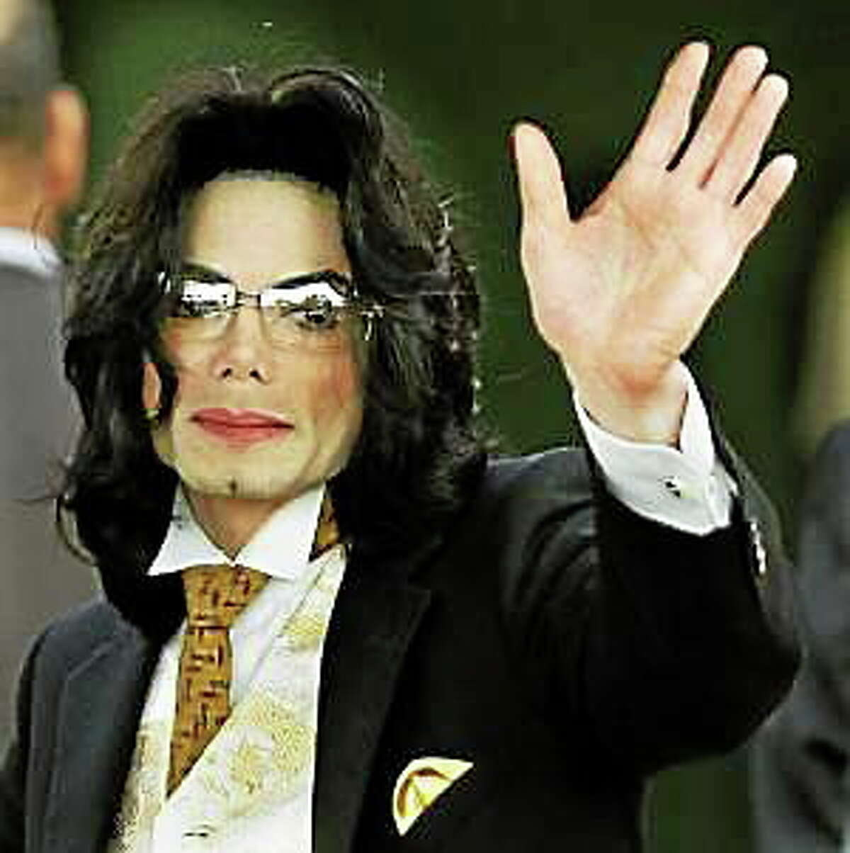 Michael Jackson waves as he arrives at the Santa Barbara County courthouse on June 3, 2005, in Santa Maria, California.