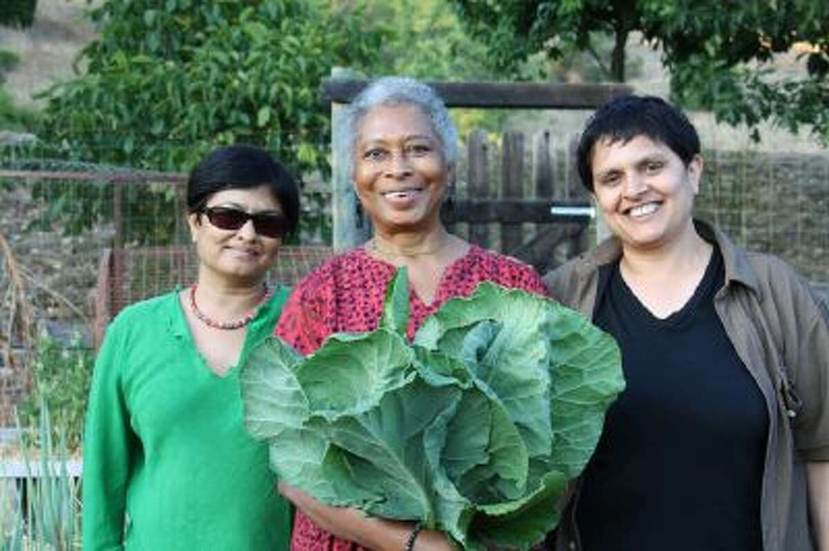 Alice Walker, center, stands with director Pratibha Parmar, left, and producer Shaheen Haq of American Masters