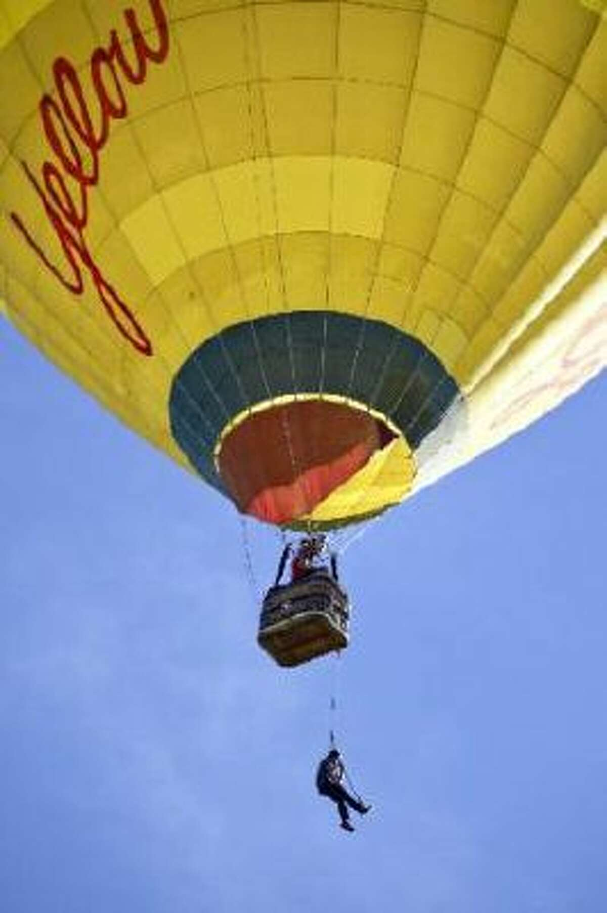 20131022_BALLOON_3269.jpg Dan Vinson hangs from a hot air balloon while filming a video to promote a Kickstarter campaign for Monkii Bars, portable fitness equipment, Tuesday, Oct. 22, 2013, over Longmont. (Matthew Jonas/Times-Call)