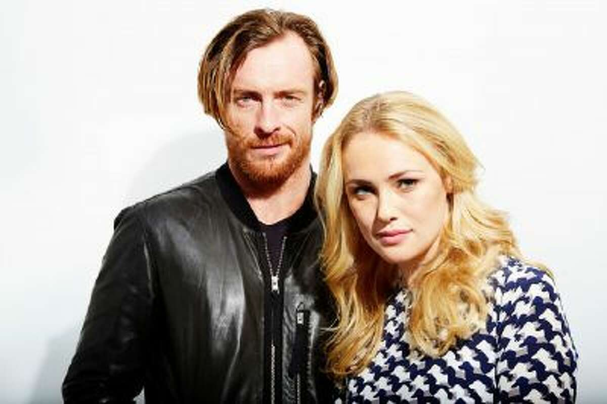 This Oct. 15, 2013 photo shows Toby Stephens, left, and Hannah New, from the new Starz original series,