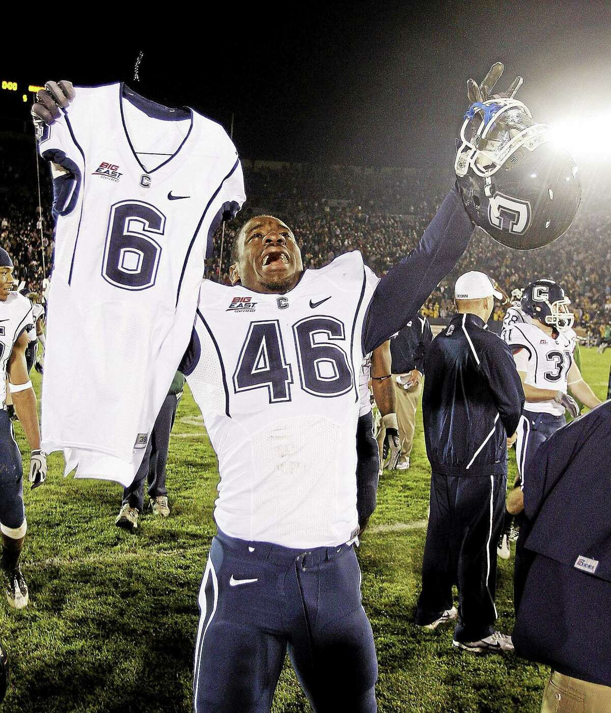 UConn linebacker Sio Moore carries the jersey of Jasper Howard after the Huskies defeated Notre Dame 33-30 in double overtime on Nov. 21, 2009, in South Bend, Ind.