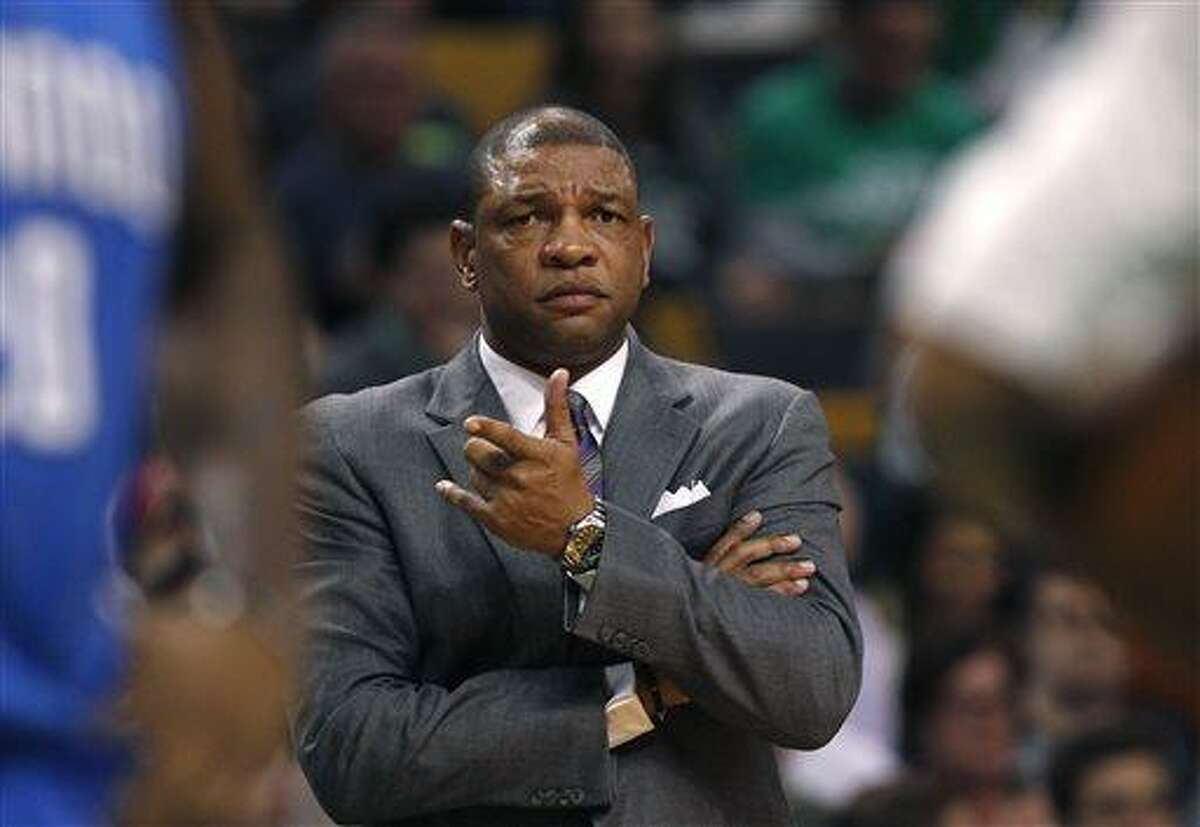 FILE - In this file photo made Feb. 1, 2013, Boston Celtics head coach Doc Rivers gestures towards an official during an NBA basketball game against the Orlando Magic in Boston. A Celtics official told The Associated Press, Sunday, June 23, 2013, that a deal to allow Rivers to coach the Los Angeles Clippers has been agreed to. The official spoke on the condition of anonymity because the deal was contingent on NBA approval and negotiations between Rivers and the Clippers over a new contract. (AP Photo/Charles Krupa, file)