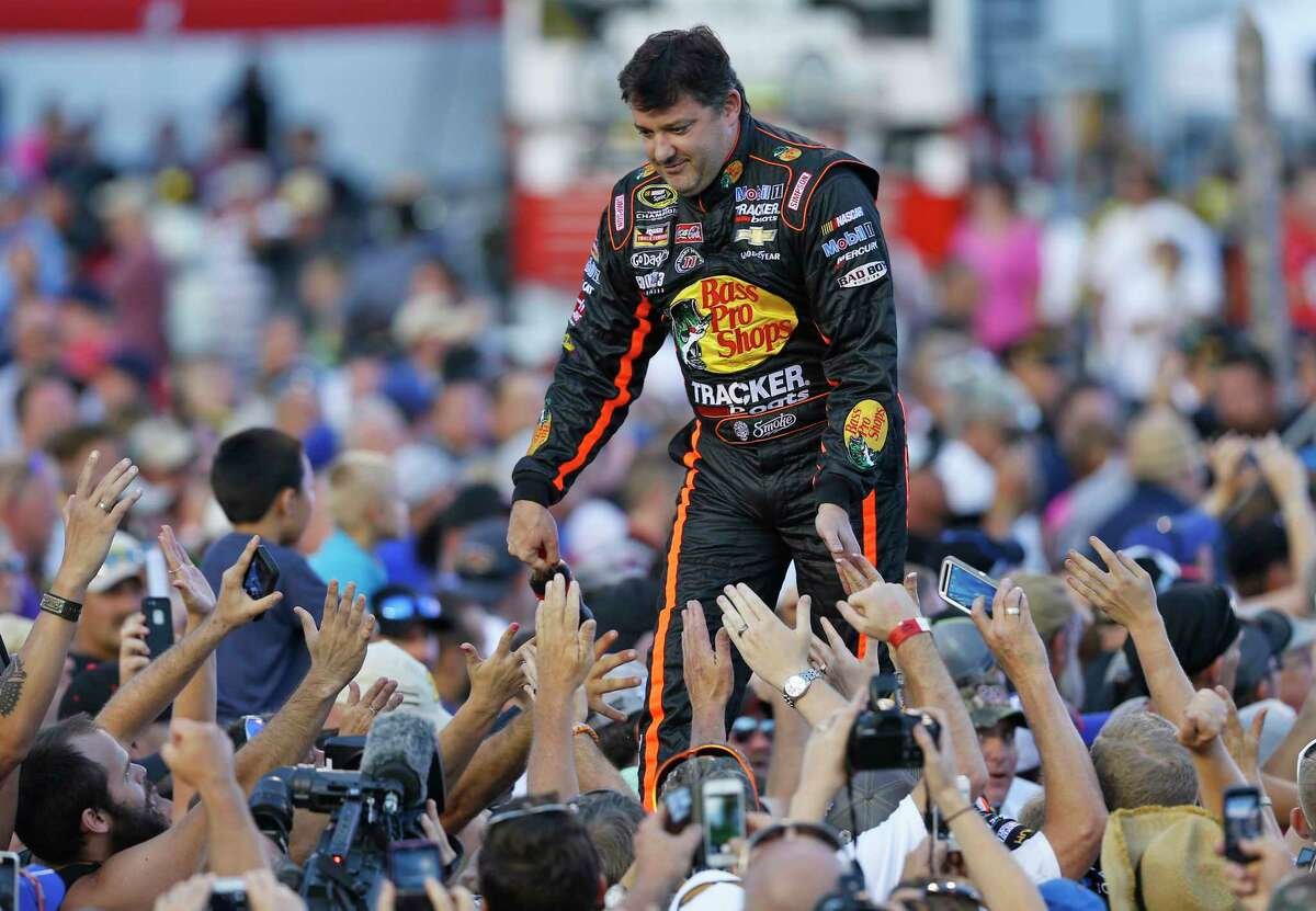 Tony Stewart greets fans during driver introductions prior to the start of the NASCAR Sprint Cup race at Richmond International Raceway on Saturday in Richmond, Va.