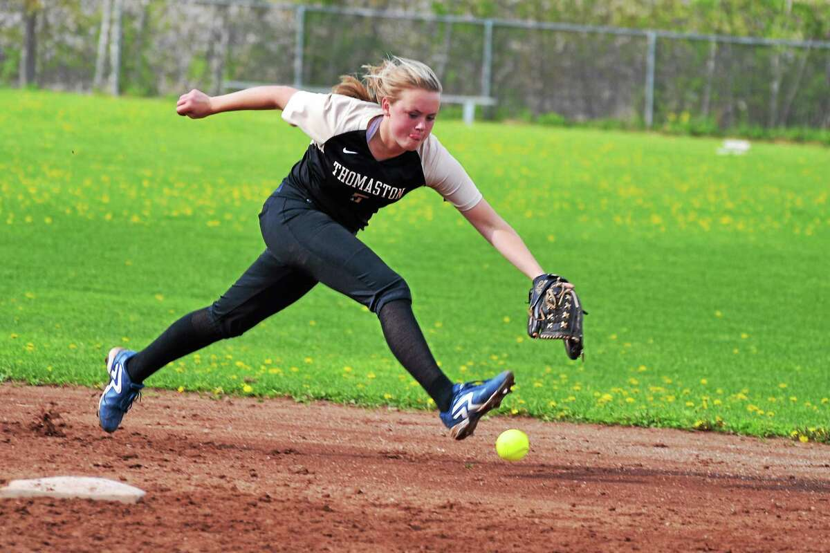 Thomaston's Abby Hurlbert reaches for a ground ball, that got passed her for a base hit.