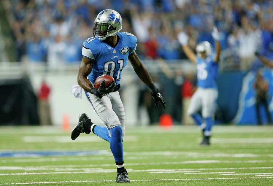 Lions wide receiver Calvin Johnson runs for a 67-yard touchdown reception in the first quarter during Monday's game against the New York Giants in Detroit. Photo: Rick Osentoski — The Associated Press  / FR170444 AP