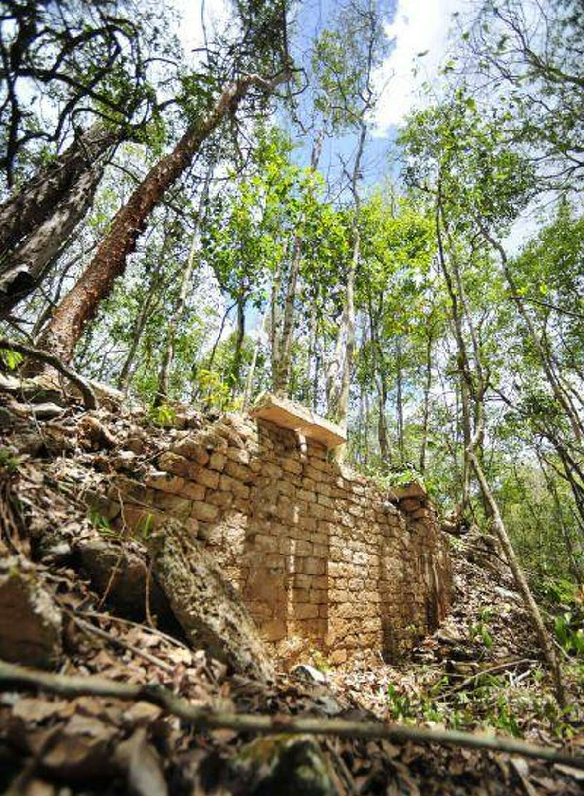 The remains of a building are pictured at the newly discovered ancient Maya city Chactun in Yucatan peninsula in this undated handout picture by National Institute of Anthropology and History (INAH) made available to Reuters June 18, 2013. Archaeologists have found the ancient Maya city that remained hidden for centuries in the rain forests of eastern Mexico, a discovery in a remote nature reserve they hope will yield clues about how the civilization collapsed around 1,000 years ago. REUTERS/INAH/Handout via Reuters (MEXICO - Tags: ENVIRONMENT SOCIETY TRAVEL) ATTENTION EDITORS - THIS IMAGE WAS PROVIDED BY A THIRD PARTY. FOR EDITORIAL USE ONLY. NOT FOR SALE FOR MARKETING OR ADVERTISING CAMPAIGNS. THIS PICTURE IS DISTRIBUTED EXACTLY AS RECEIVED BY REUTERS, AS A SERVICE TO CLIENTS